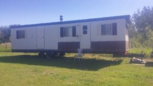 older portable 35 ft trailer or tiny home