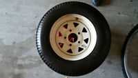 Trailer wheel and tire for sale  Not sure of size but measures v