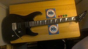 Jackson Dinky electric guitar with gig bag +extras