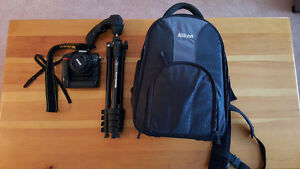 For sale!! NikonD7000 with grip and 35mm lens and accessories