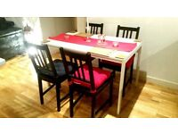 white wooden table and 4x wooden chairs with cushions