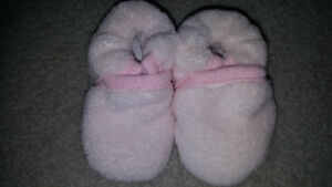 6 month slippers brand new still attached together