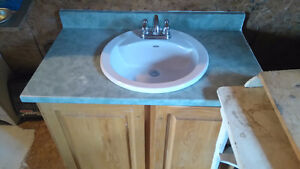 Oak cabinet sink and faucets