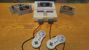 Super Nintendo SNES System with 4 Games and 2 Controllers