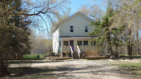 Country Home on Riverfront Acreage