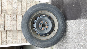 A set of four used winter tires 205/70R15 on rims for sale.