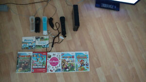 Barely used Black Wii + Accesories + 7 Games!!!