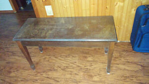 Sturdy hardwood piano bench.