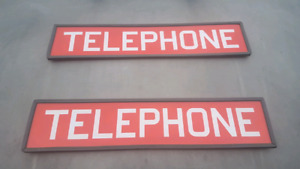 Telephone booth glass signs.