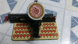 Antique Toy Telephone and Typewriter