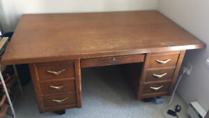 Large brown wooden kneehole desk