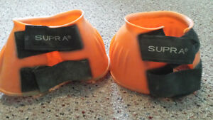 Orange bell boots (horse sized)