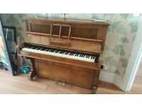 Exquisite Walnut Piano with a fabulous case and all working good, nice tone.