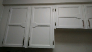 Kitchen cabinet doors, hinges and handles and extras.