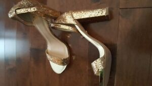 New High heels. Gold in color. Price reduced.