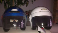 Two new helmets one blue and one white