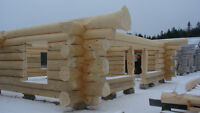 handcrafted  log home shell- diamond cut notches
