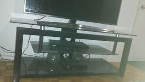 Glass TV stand for urgent sale