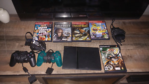 Mint condition PS2 with 5 games 2 controllers
