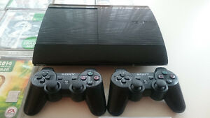 PS3 slim console (500 GB) , 2 wireless controllers, and 17 game