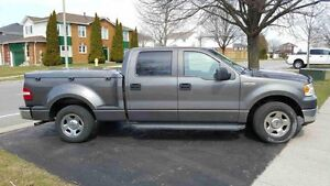 2007 Ford F-150 SuperCrew Pickup Truck with sidestep