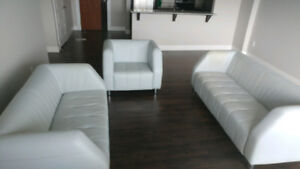 Entertainment/Living room set, couch, love set and single chair.