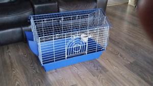 Cage equipee neuve.