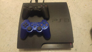 Sony PS3 + 2 Controllers + 8 Games
