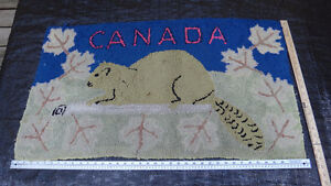 Antique beaver and Canada hooked rug