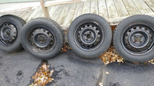 Snow tires w\wheels..  185\65\14
