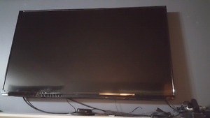 "43"" Toshiba flat-screen TV with wall mount"