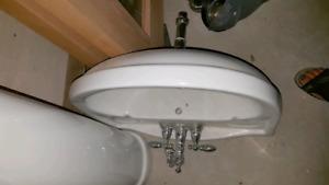 Pedestal white sink with delta taps still working before remodel