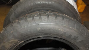 Four 215/60/16 studded winter tires