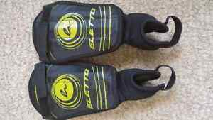 Boys soccer cleats and chin pads Kitchener / Waterloo Kitchener Area image 2