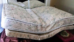 Adjustable double bed. Selling for 10% of my original cost
