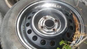 Four 175/65/14 motomaster aw all season tires on rims 4x100