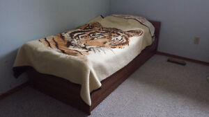 Two single wood beds with mattresses