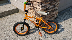 "Bright orange Supercycle 16"" bike"