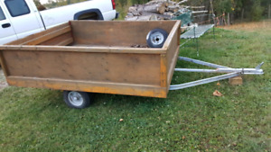 "Utility trailer.   2"" ball with spare tire."