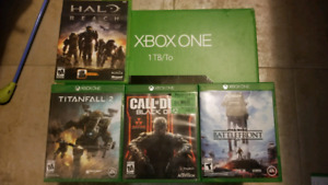 Xbox one 1TB, controller and 4 games.