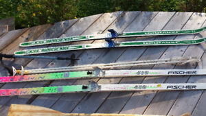 3 sets of ski s and poles