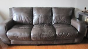 brown leather couch and two chairs