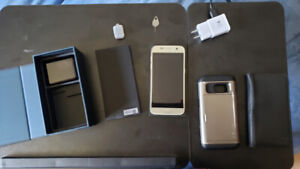 Used Samsung Galaxy S7 32GB with original box and 2 cases.