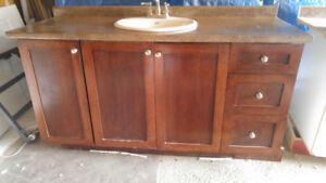 For sale two  gently used solid wood bathroom vanities
