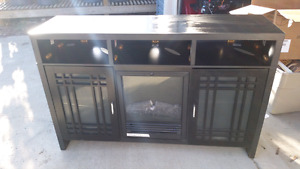 Black TV stand with built in electric fire place