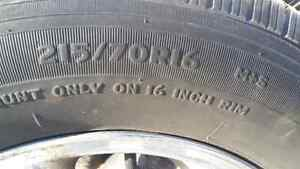 4 215/70R16 tires mounted on aluminum rims off 2003 Buick Rendez