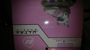 Brand new pink  rollerblades In box