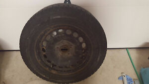 215/65R16 102T 4 winter tires with rims Used with Tiguan 2013