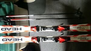 children's skis, boots, and poles