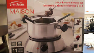 Brand new 11 piece..3 in 1 Electric Fondue set